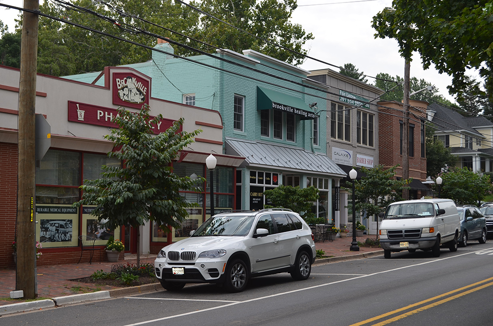The single block of retail on Brookville Road in the suburban residential neighborhood of Chevy Chase, MD is walkable, mixed-use and active – Urbanism at its best!
