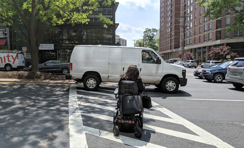 Van blocks crosswalk as person in wheelchair tries to reach median
