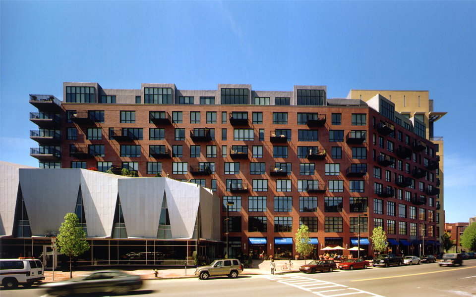 The Atelier development is made up of different color and sized masses that respond to the scale of the buildings adjacent to them. Metal panels cover a new iconic theater space which frames the new plaza to the right.