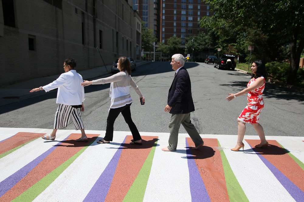 Planning Board members re-create the iconic cover of the Beatles' Abbey Road Album on the newly painted art crosswalk leading to Downtown Silver Spring. Pictured left to right, Marye Wells-Harley as John Lennon, Amy Presley as Ringo Starr, Chair Casey Anderson as Paul McCartney and Natali Fani-Gonzales as George Harrison (Norman Dreyfuss not pictured).