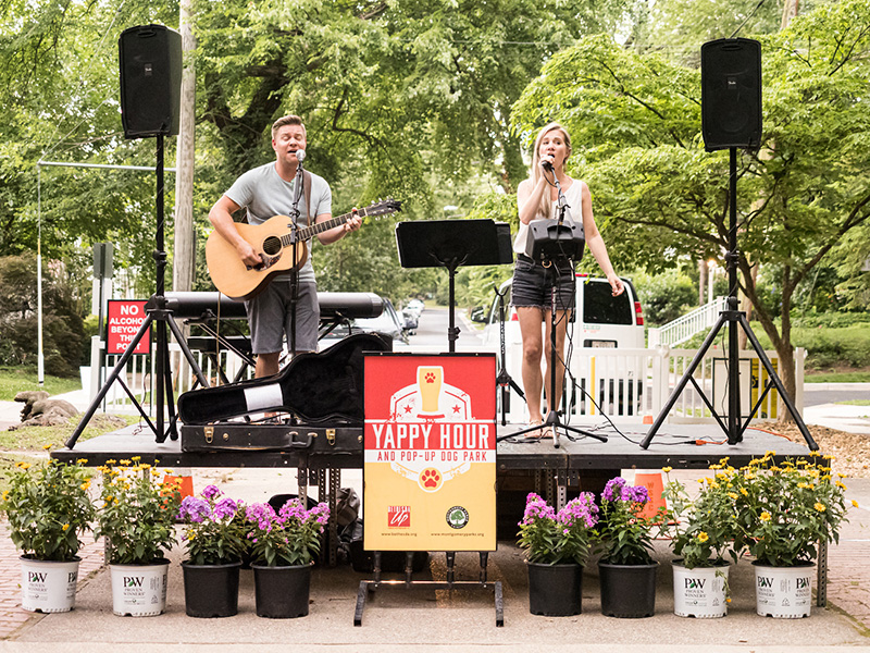 Musicians perform at Yappy Hour pop-up dog park in Bethesda