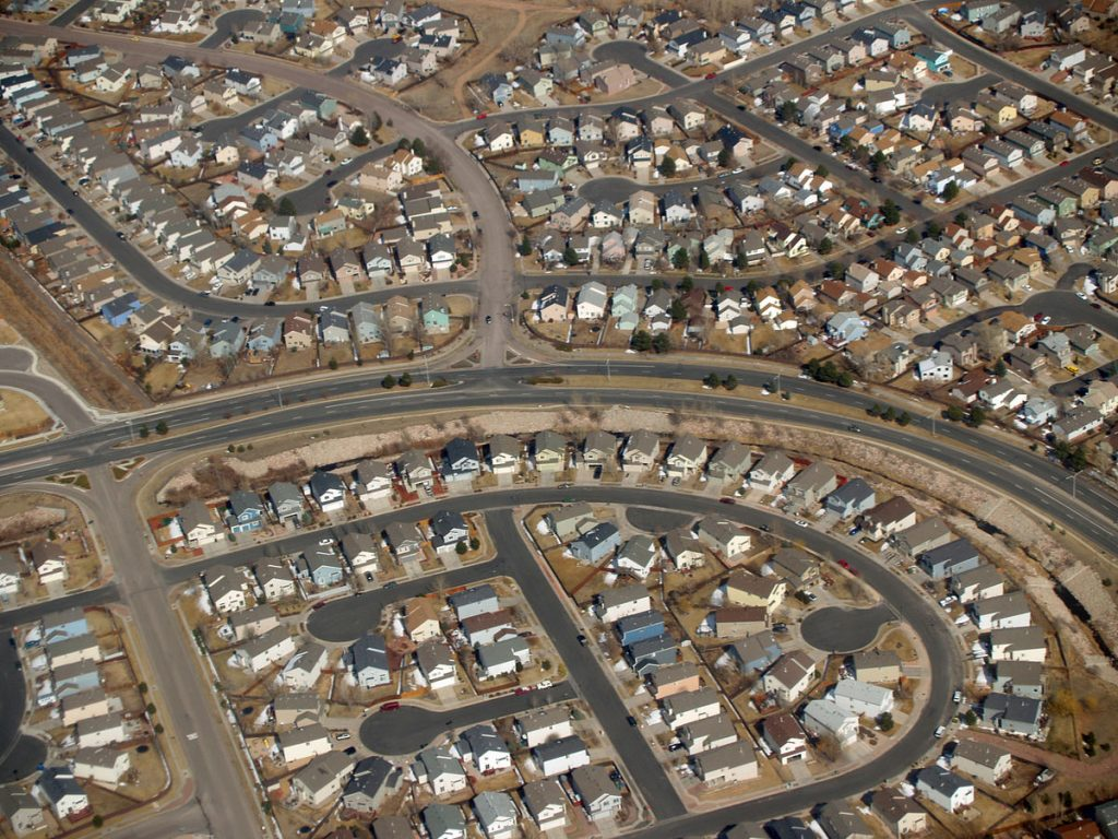 "Aerial view of suburban ""cookie-cutter"" houses"