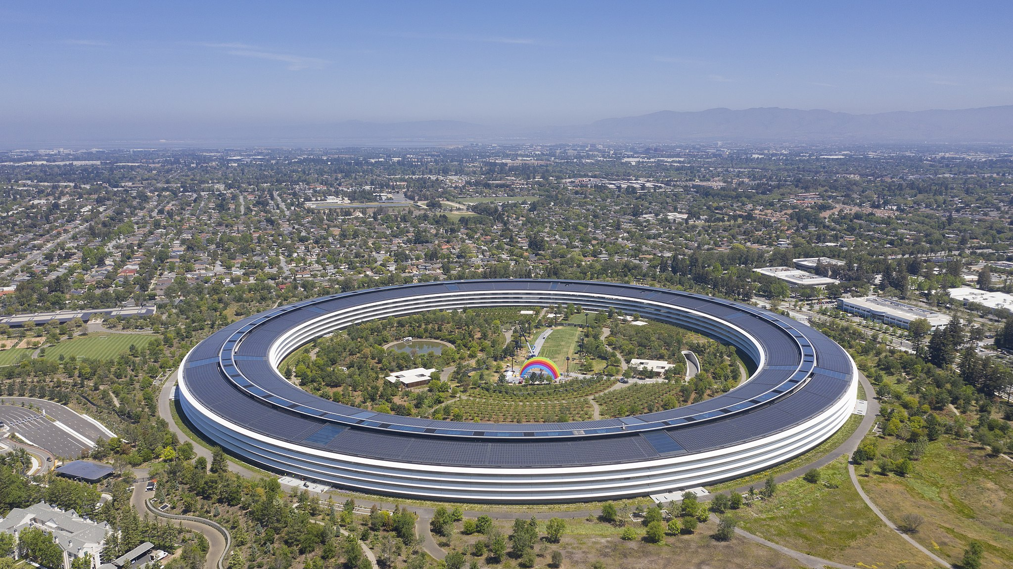 Apple Headquarters. A toric-shaped building with greenspace in the center