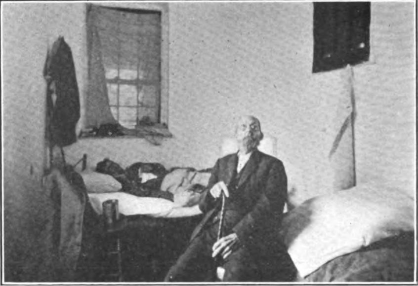 A photograph taken circa 1913 shows two people who suffered from tuberculosis at the Poor Farm, a man sitting upright on a bed, and another person lying down on another bed behind him.