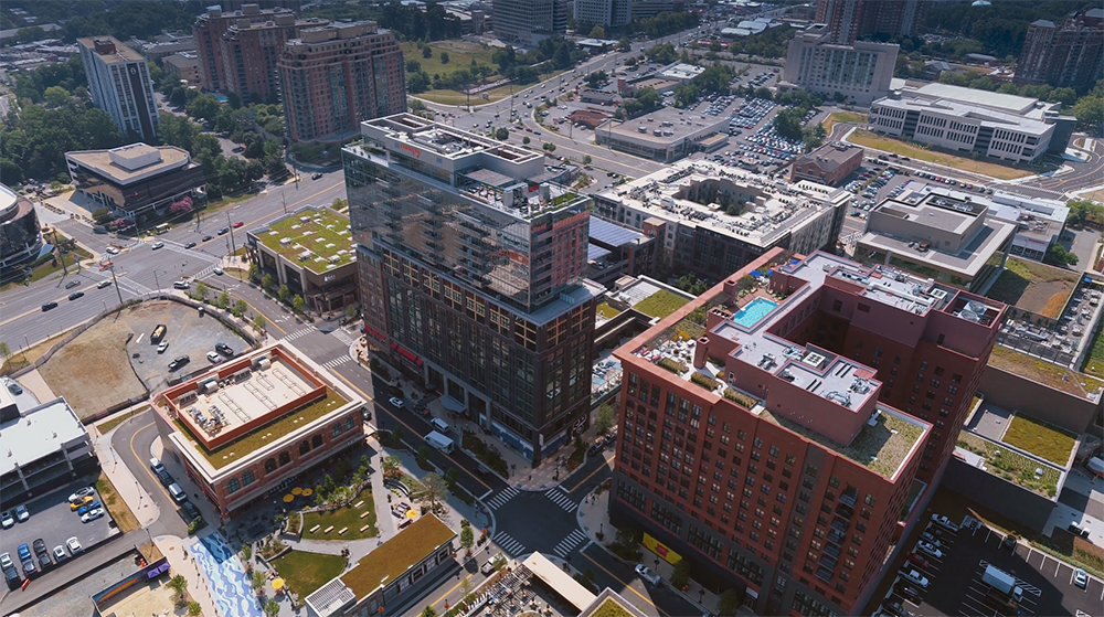 aerial photo of Montgomery County's Pike and Rose development project. Shows the camera angle looking down on office, residential, hotel and green roofs with Wisconsin Avenue corridor to the left looking south.