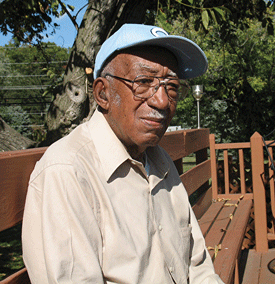Francis Wilson Wims, an older African American man in a baseball cap looking to the side.