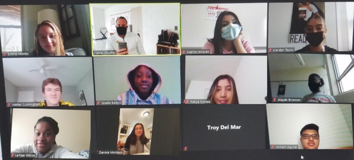 A screen capture of a teacher and students showing a gallery of individual faces.