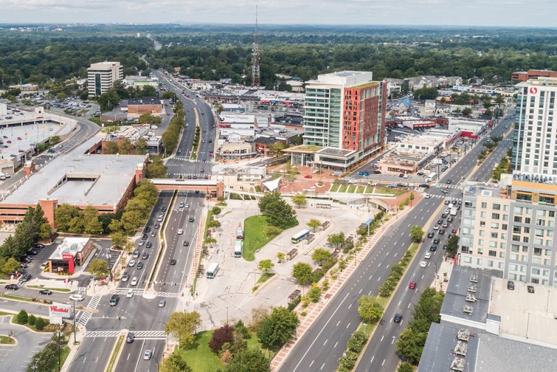 an aerial photo of downtown Wheaton looking north on Georgia Avenue showing the Wheaton Headquarters building in the background with Veirs Mill Road and Georgia Avenue coming together at a crossroads next to the Wheaton Westfield Mall.