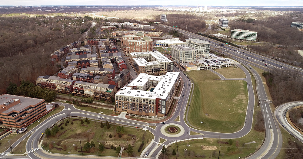aerial view of Montgomery County's Park Potomac looking north toward Frederick, MD. Shows the compact and high-density development of townhomes and condos, retail and office uses to the left of I-270.