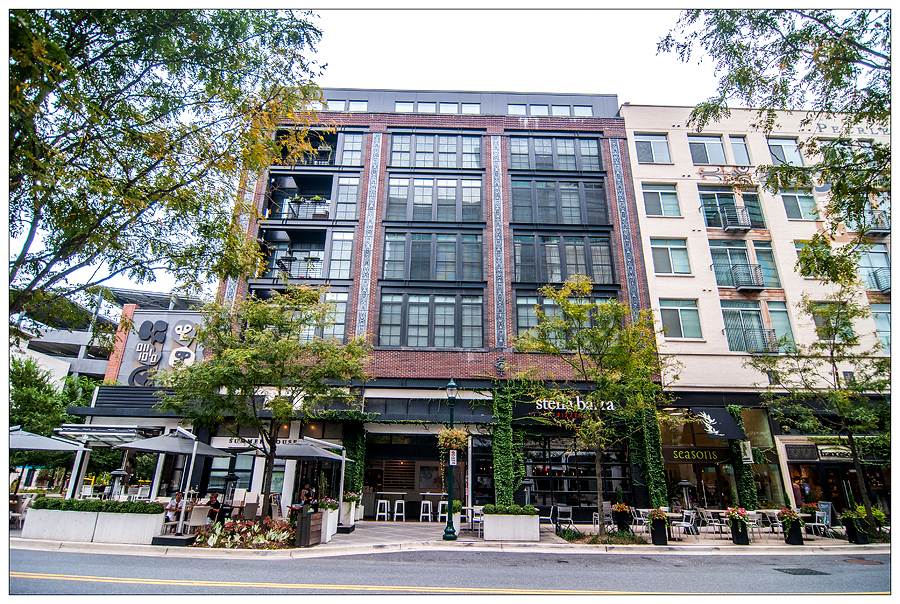 A mixed-use development in Pike & Rose is shown with a restaurant located on the ground floor with residences on top.