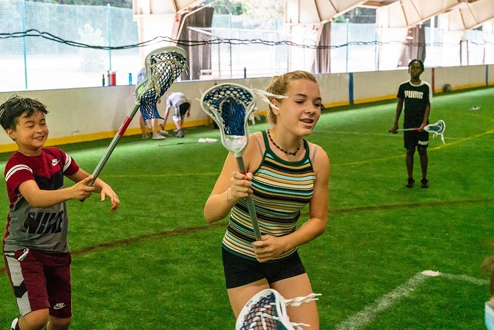 photo of kids playing lacrosse at Montgomery Parks' All Sports Camp at the Wheaton Sports Pavilion