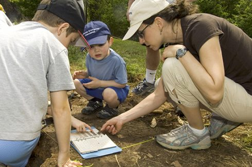 Parks visitors participate in an archeology activity.