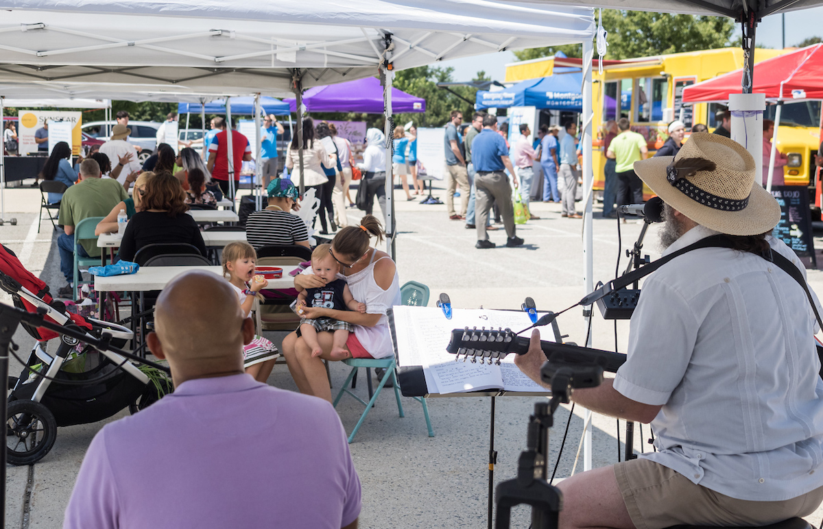 Family listens to live music at Shady Grove Farmers Market