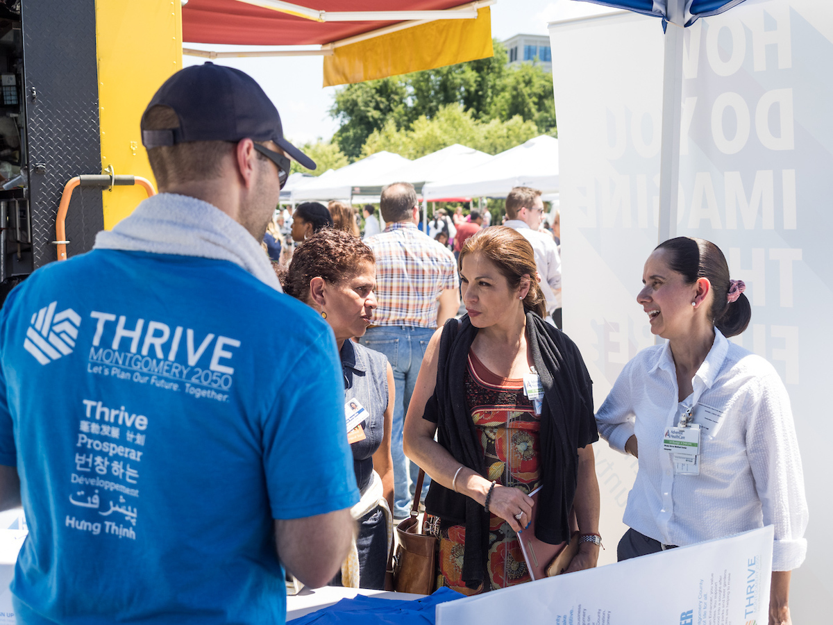Montgomery Planning staff talk with community membersat June 26 Thrive Week event at Shady Grove Farmers Market