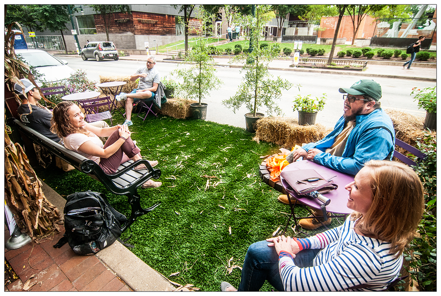 People enjoying a parklet in downtown Silver Spring during Park(ing) Day 2018