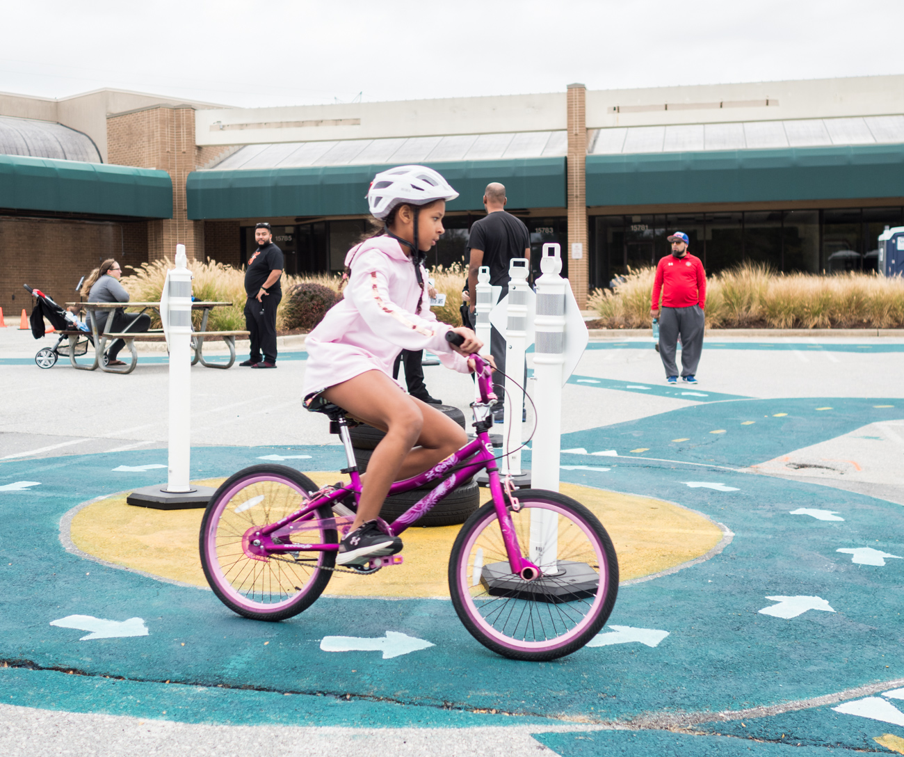 Child on bike at Burtonsville Placemaking Festival