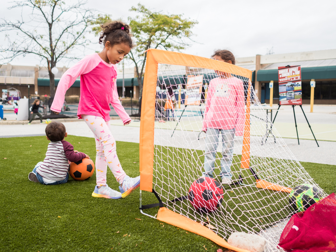 Children playing soccer at Burtonsville Placemaking Festival