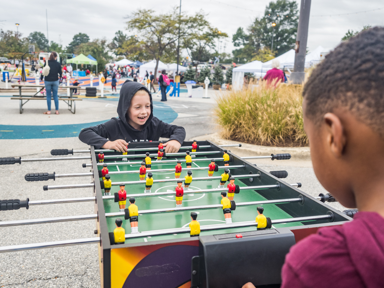 Childredn playing Foosball at Burtonsville Placemaking Festival