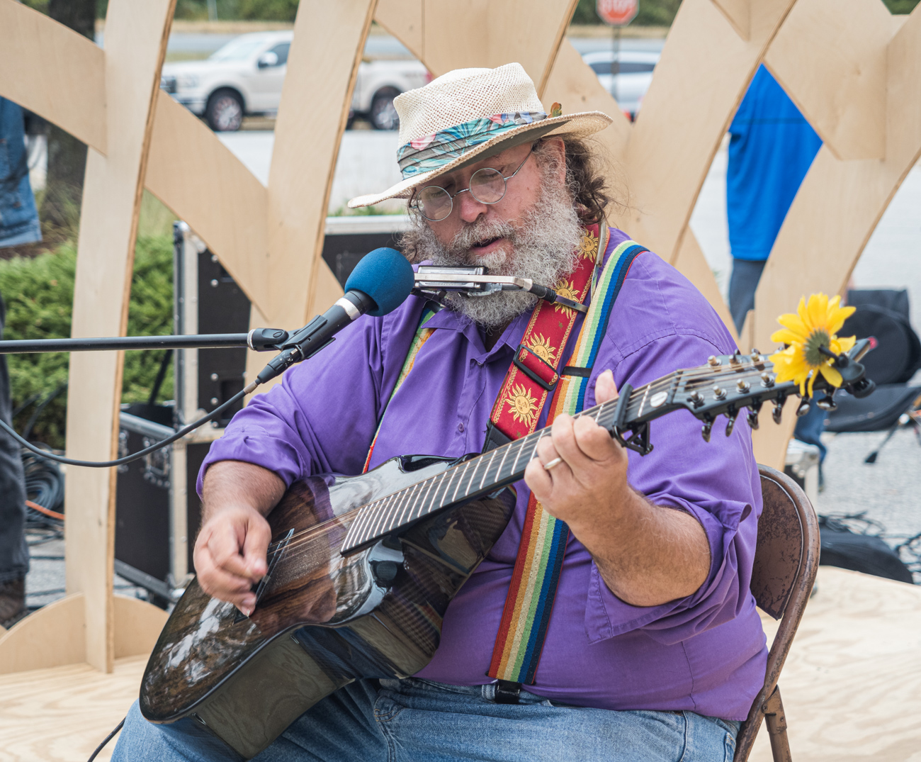 Musician on stage at Burtonsville Placemaking Festival