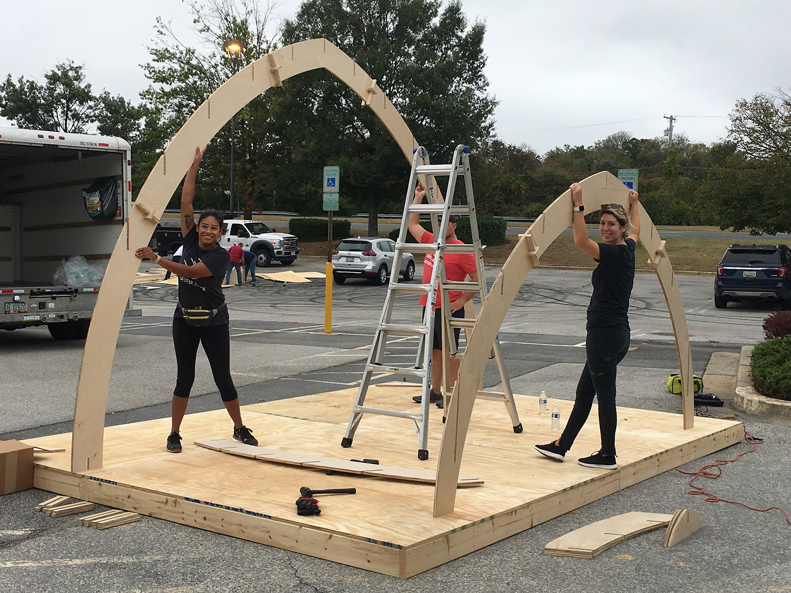 Volunteers construct stage for Burtonsville Placemaking Festival