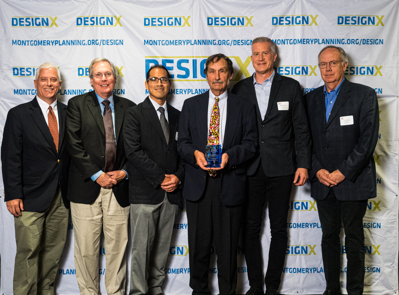 2019 Design Excellence Award winners with Planning Board Chair Casey Anderson