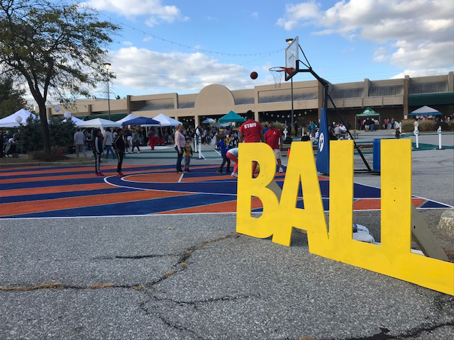 "Basketball court beside giant standing letters ""BALL"" at Burtonsville Placemaking Festival"