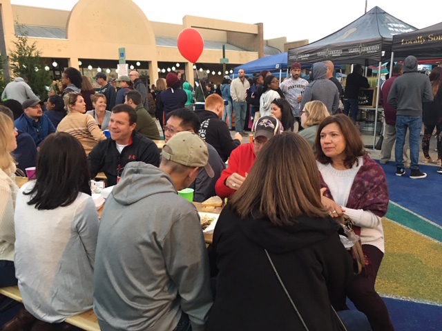 People eating at table, Burtonsville Placemaking Festival