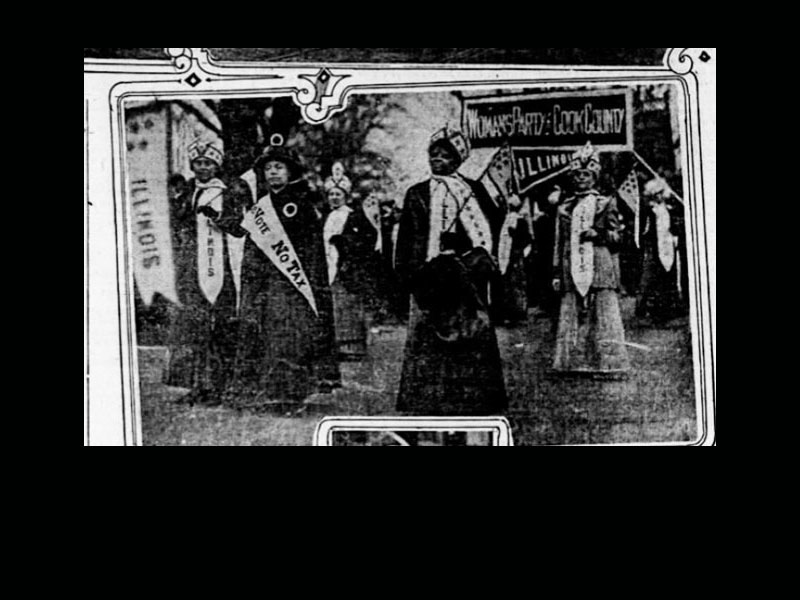 Ida B. Wells holding a flag and marching among other women holding pro-suffrage banners.