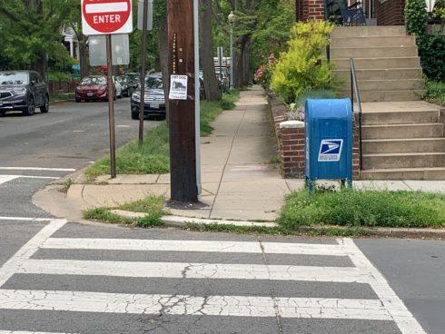 a crosswalk heading into a curb