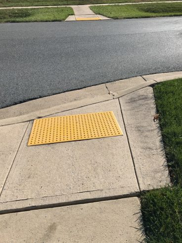 a crosswalk with a yellow mat