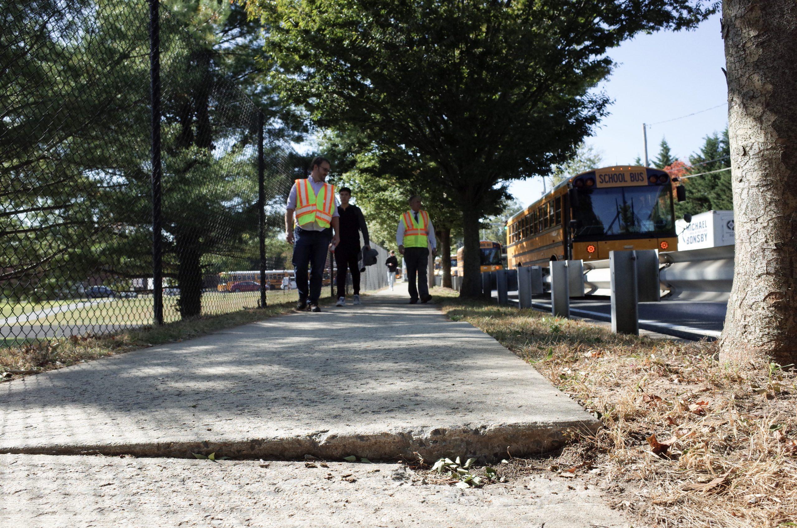 A sidewalk tripping hazard near a school in Ashton