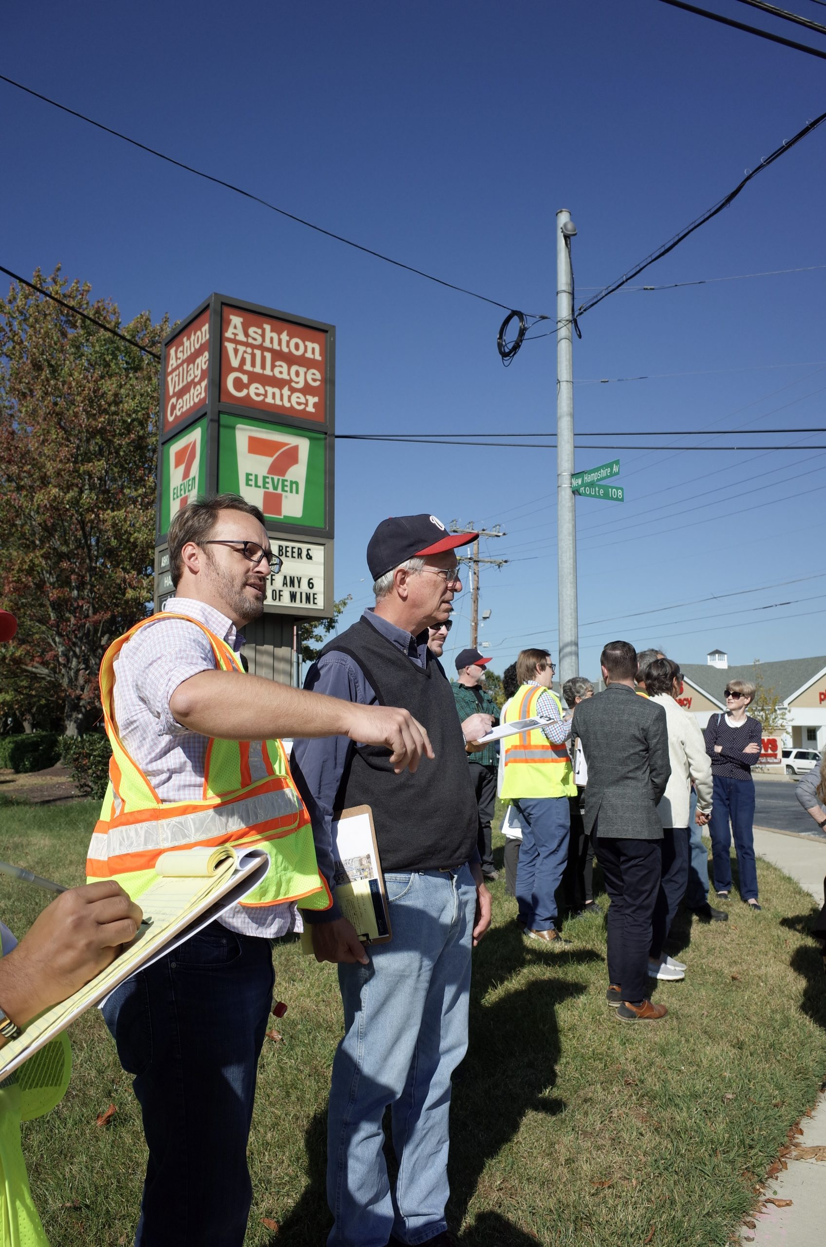 Community members and County staff survey pedestrian conditions in Ashton