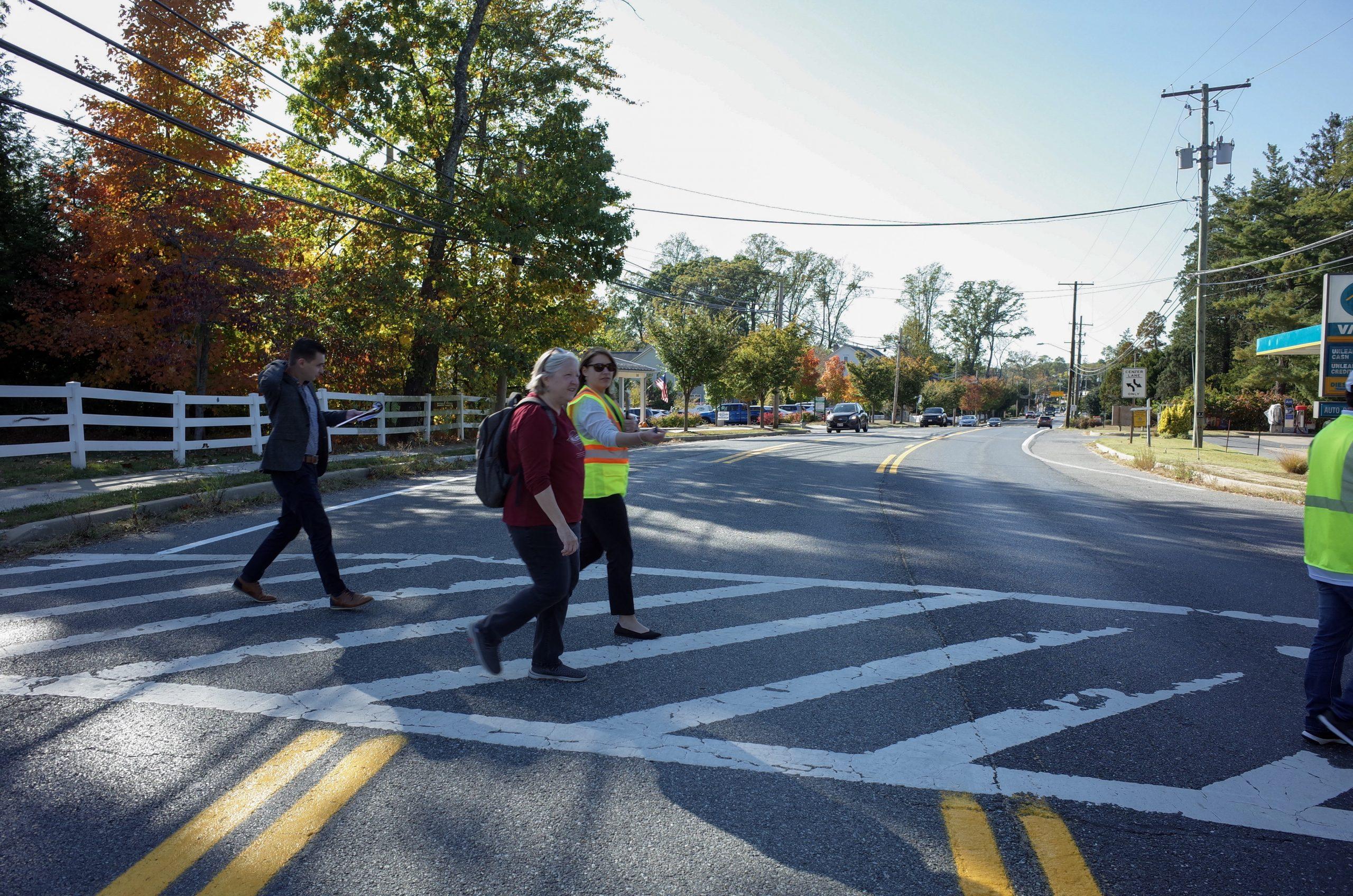 Ashton pedestrian audit participants cross Olney-Sandy Spring Road using a marked crosswalk